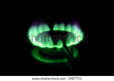 Green flames of gas stove. - stock photo