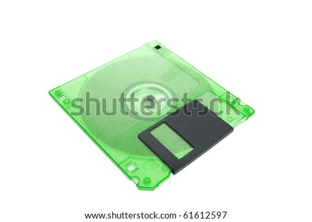 Green floppy disk magnetic computer data storage support isolated over white background - stock photo