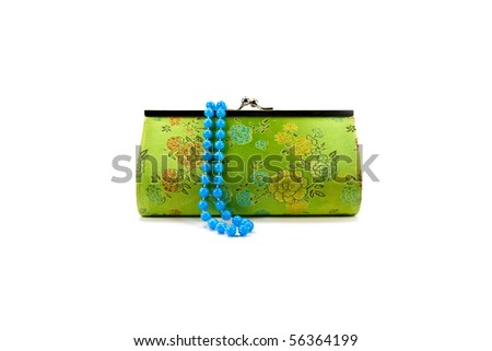Green floral handbag with beads - stock photo