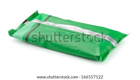 Green foil food package isolated on white - stock photo