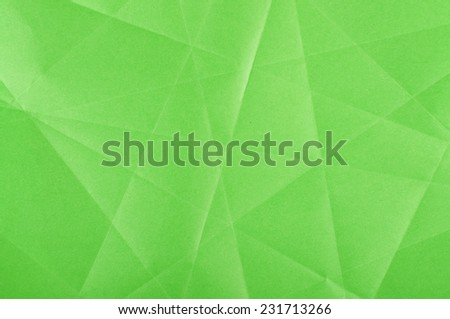 Green folded paper surface abstract - stock photo