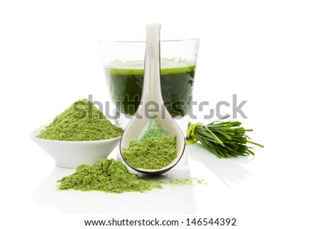Green food supplement. Wheatgrass blades, green ground powder and green drink isolated on white background. Healthy lifestyle. - stock photo