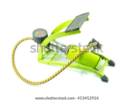 Green foot air pump on white background - stock photo