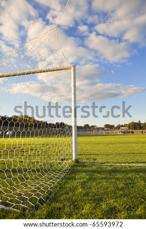 Green football pitch goal post and net - stock photo