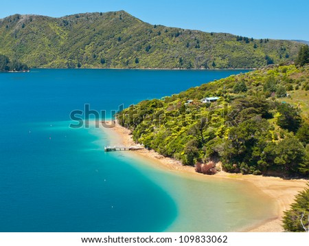 Green forest and blue water in the Marlborough sounds, New Zealand - stock photo