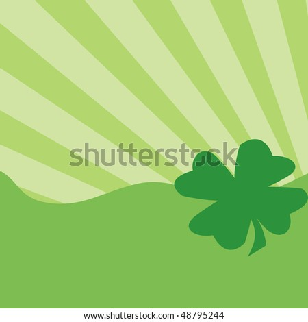 Green four-leaf clover on green background - stock photo