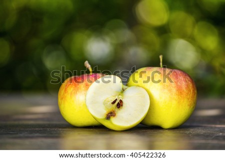 green fresh sweet apples on the table - stock photo