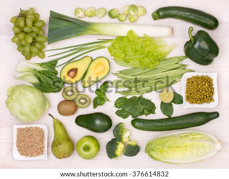 Green fruit and vegetables, top view - stock photo