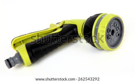 Green garden water hose with adjustable spray nozzle and rubber grip - stock photo