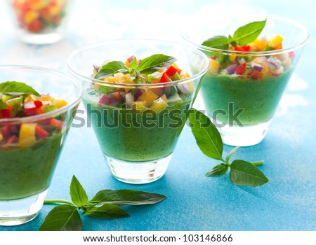 Green Gazpacho soup in glasses - stock photo