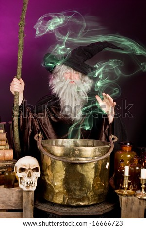 Green ghost leaving the cooking pot of a Halloween sorcerer - stock photo