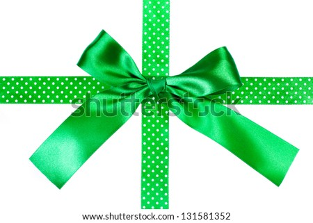 Green gift bow and ribbon on white background