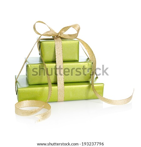 Green gift box isolated - wrapped in green paper with golden ribbon for Christmas  - stock photo