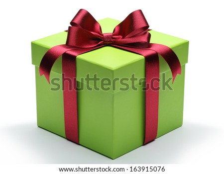 Green gift box with red ribbon bow isolated on white background. - stock photo