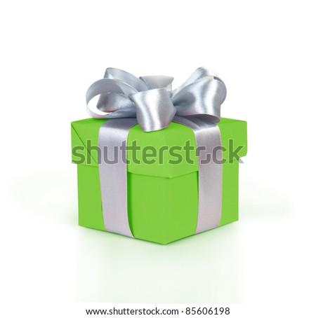 green gift box with silver ribbon and bow isolated on white - stock photo