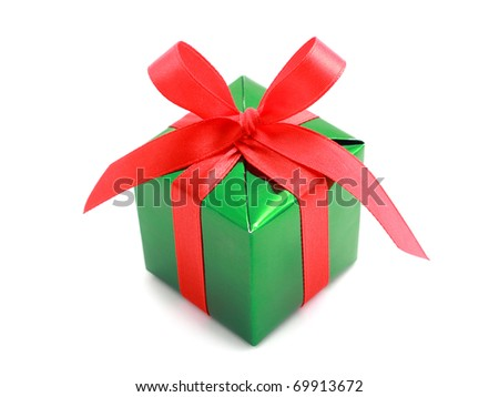 Green gift wrapped present with red satin ribbon bow isolated on white - stock photo