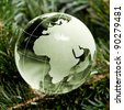 Green Glass globe Christmas tree on the background mast - stock photo