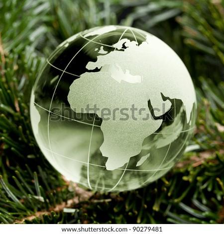 Green Glass globe Christmas tree on the background mast - stock photo