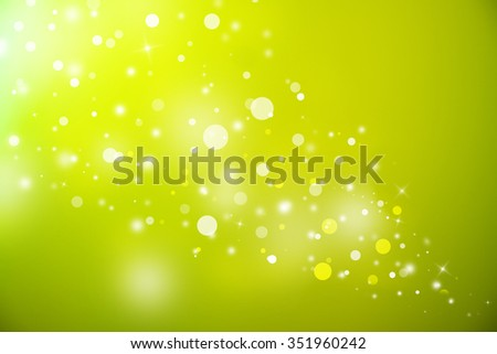Green glitter sparkles defocused rays lights bokeh abstract christmas background.