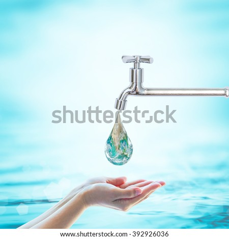 Green globe droplet fall on woman human hand from water tap on blur blue sea ocean background: World environmental protection: Saving aqua conceptual csr idea: Element of this image furnished by NASA - stock photo