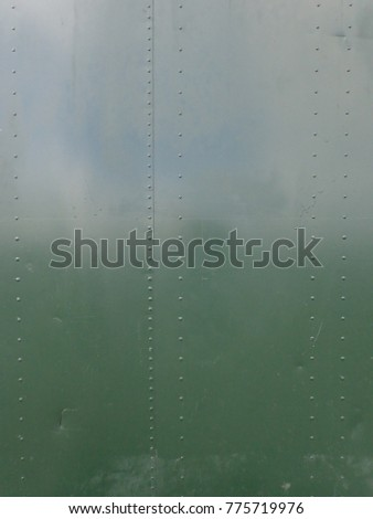 Green Gloss painted metal sheet with small rivets
