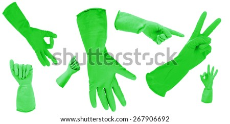 Green gloves gesturing numbers isolated on white - stock photo