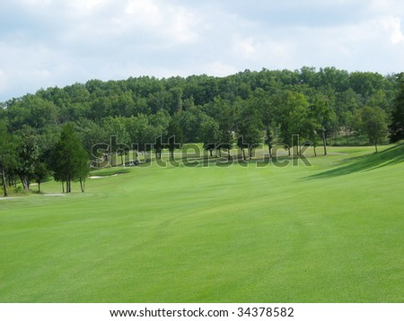 Green golf course with space for text - stock photo