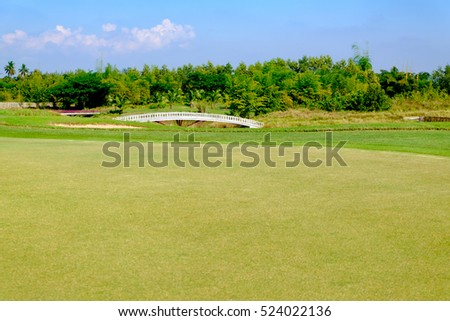 green golf field and blue cloud sky for backdrop background use