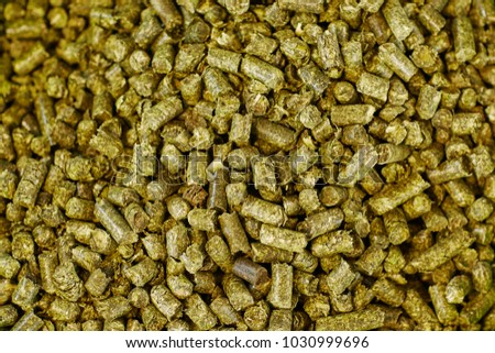 Green granulated animal food background texture