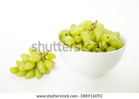 green grape in bowl diet fruit organic on white background - stock photo