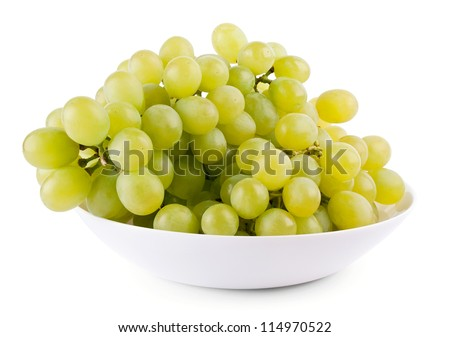 Green grape on plate on white background - stock photo