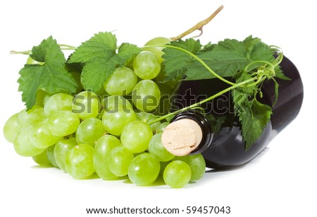 green grape wirh bottle of wine on white background