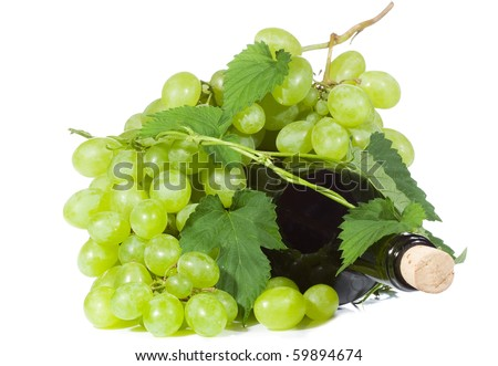 green grape with bottle of wine on white background