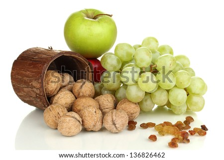 Green grape with nuts isolated on white - stock photo