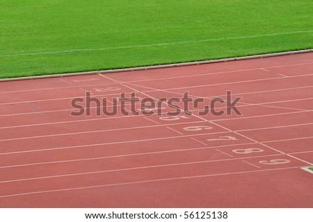 green grass and running lane - stock photo