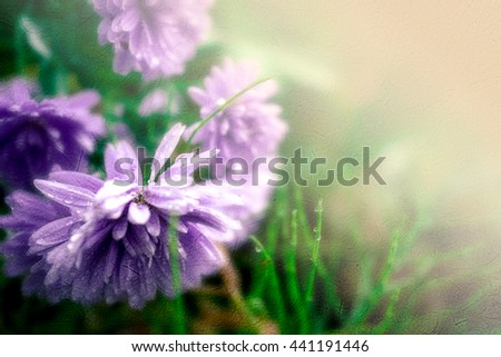 green grass and violet flowers on mulberry paper texture background - stock photo