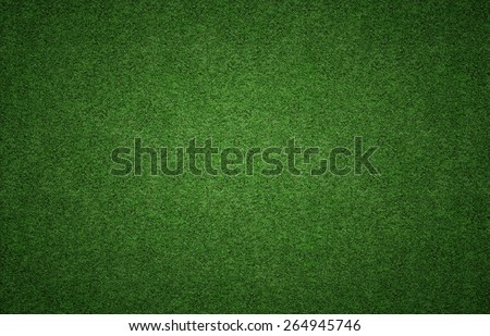 Green grass background texture with grunge lighting and lots of copy space. Perfect for sport designs - stock photo