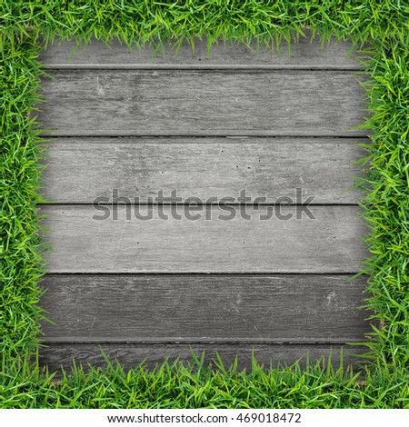 Green grass frame with vintage wooden pattern and texture background.