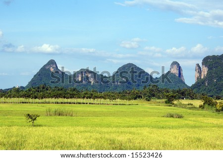 Green grass, hills and sky in south Thailand