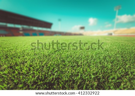 Green grass in soccer stadium. soccer field and stadium. sport stadium in thailand. - stock photo