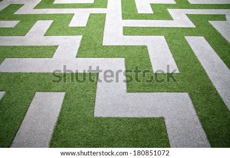 Green grass maze. - stock photo