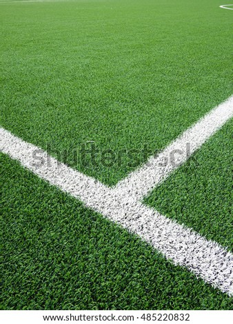 green grass of football field with white lines
