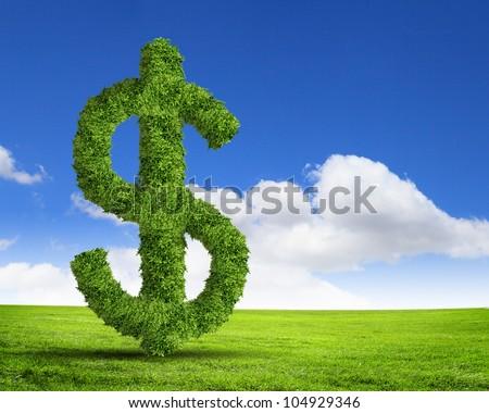 Green grass  US dollar symbol against blue sky - stock photo