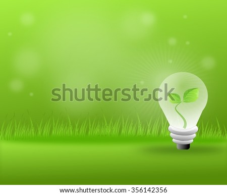 Green grassy background with light bulb with leaves
