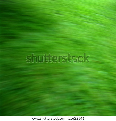 Green grassy background with motion blue in square format
