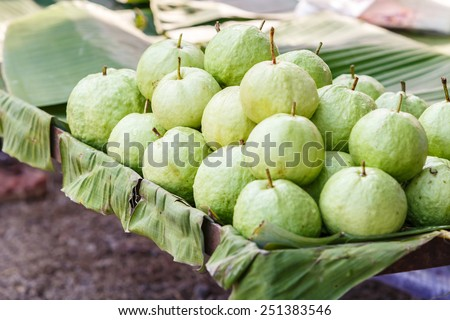 Green guava on banana leave - stock photo