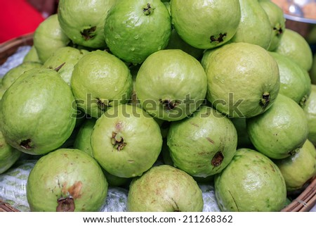 Green guavas. Green guavas fruit on sale at fruit market. - stock photo