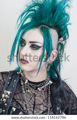 green haired postpunk girl on grey background - stock photo