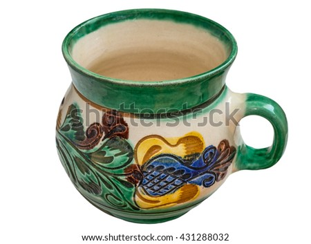 Green hand made ceramic mug with ornament, isolated on white background