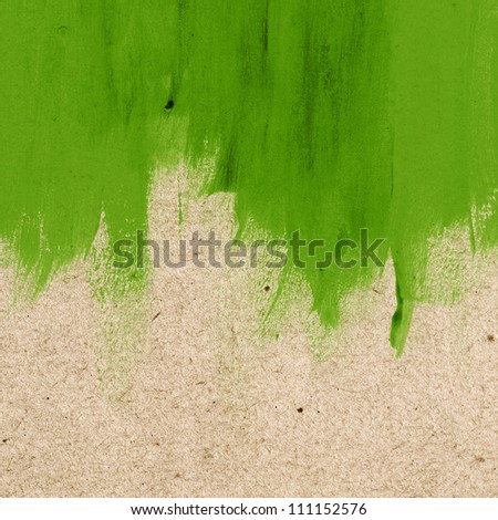 Green hand-painted brush stroke daub background over old vintage paper - stock photo